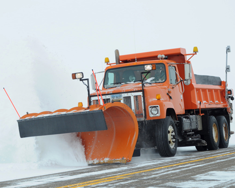 Snowplow removing snow from roadway